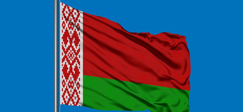 Flag Of Belarus Waving In The Wind Against Deep Blue Sky. Belaru